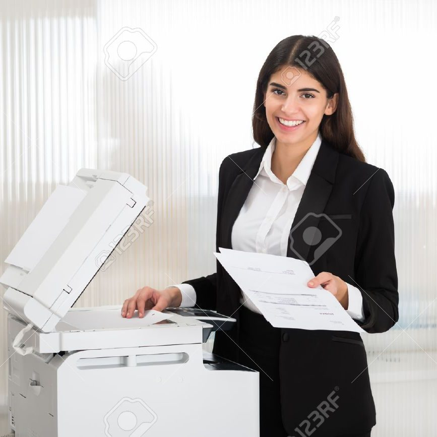 51726270-young-businesswoman-using-photocopy-machine-in-office